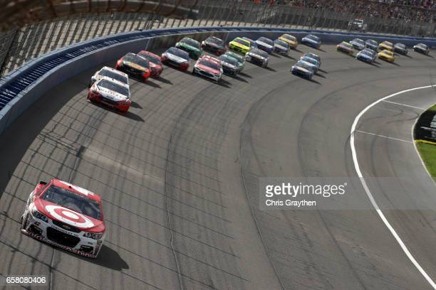 Kyle Larson driver of the Target Chevrolet leads a pack of cars during the Monster Energy NASCAR Cup Series Auto Club 400 at Auto Club Speedway on...