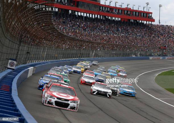 Kyle Larson driver of the Target Chevrolet leads the field to start the Monster Energy NASCAR Cup Series Auto Club 400 at Auto Club Speedway on March...