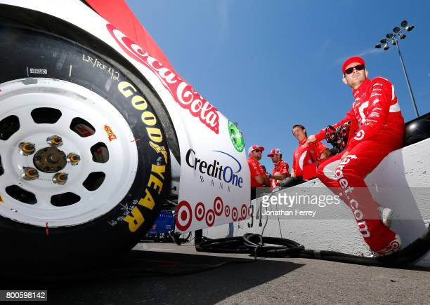 Kyle Larson driver of the Target Chevrolet sits by his car during qualifying for the Monster Energy NASCAR Cup Series Toyota/Save Mart 350 at Sonoma...