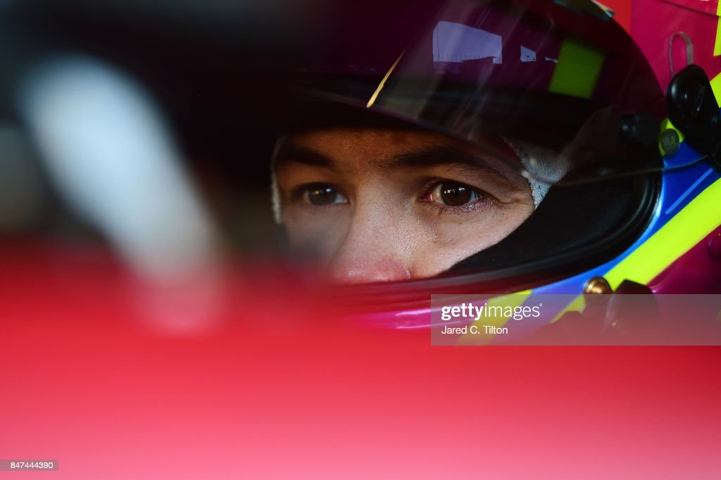 Kyle Larson, driver of the #42 Target Chevrolet, sits in his car during practice for the Monster Energy NASCAR Cup Series Tales of the Turtles 400 at Chicagoland Speedway on September 15, 2017 in Joliet, Illinois.