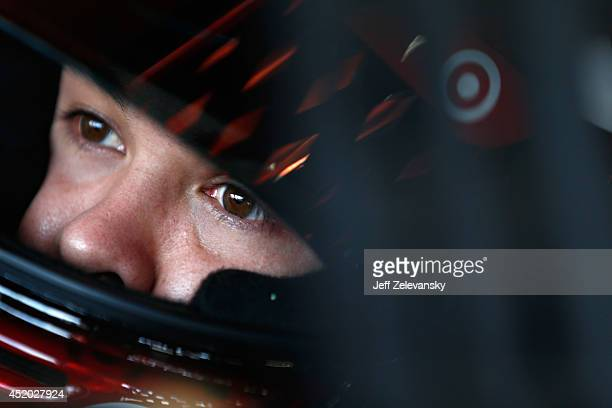 Kyle Larson, driver of the Target Chevrolet, sits in his car in the garage area during practice for the NASCAR Sprint Cup Series Camping World RV...