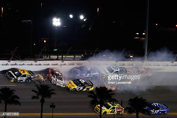 Kyle Larson, driver of the Target Chevrolet, spins making contact with Michael Annett, driver of the Pilot/Flying J Travel Centers Chevrolet, and...