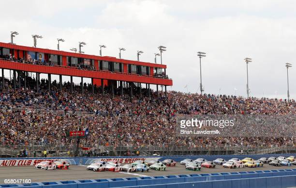 Kyle Larson driver of the Target Chevrolet takes the green flag to start the Monster Energy NASCAR Cup Series Auto Club 400 at Auto Club Speedway on...