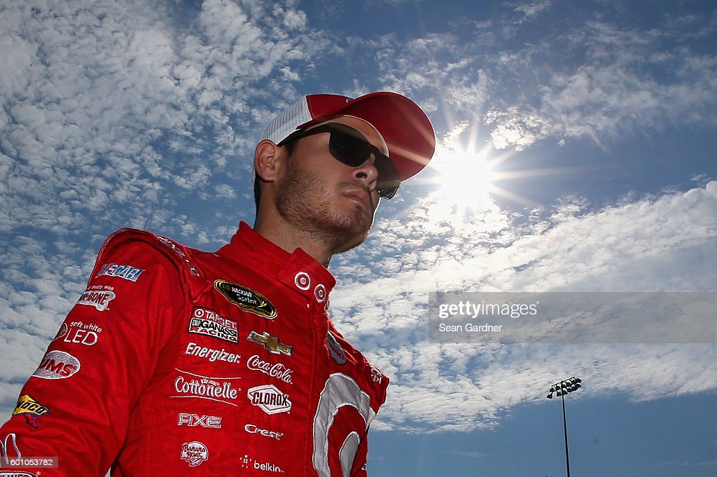 Kyle Larson, driver of the #42 Target Chevrolet, walks through the garage area during practice for the NASCAR Sprint Cup Series Federated Auto Parts 400 at Richmond International Raceway on September 9, 2016 in Richmond, Virginia.