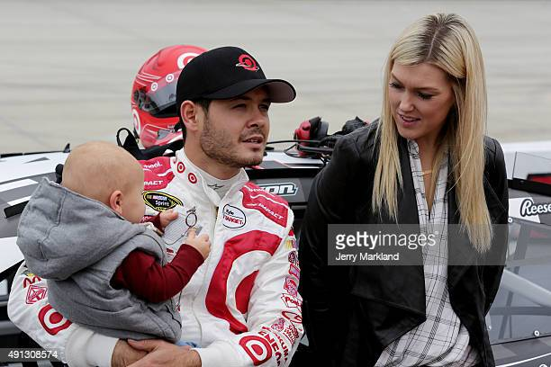Kyle Larson driver of the Target Plaid Chevrolet center takes part in prerace ceremonies with son Owen and girlfriend Katelyn Sweet right prior to...