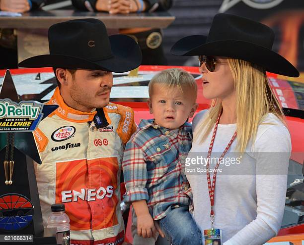 Kyle Larson ENEOS Chevrolet Chip Ganassi Racing son Owen and girlfriend Katelyn Sweet celebrate the win in Victory Lane at the NASCAR XFINITY Series...