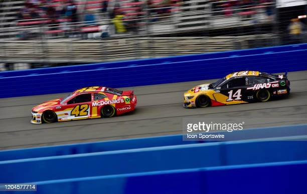 Kyle Larson McDonalds Chevrolet Chip Ganassi Racing leads pole winner Clint Bowyer Rush/Haas CNC Ford StewartHaas Racing down the front straight at...