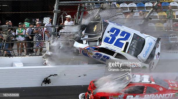 Kyle Larson's car desinegrates into the catch fench at the finish line in the final seconds of the Nationwide 300 race at Daytona International...