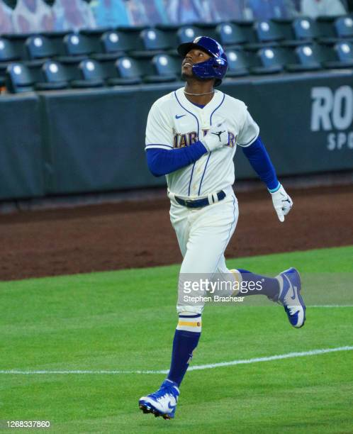 Kyle Lewis of the Seattle Mariners celebrates as he rounds the bases after hitting a home run during a game against the Texas Rangers at T-Mobile...