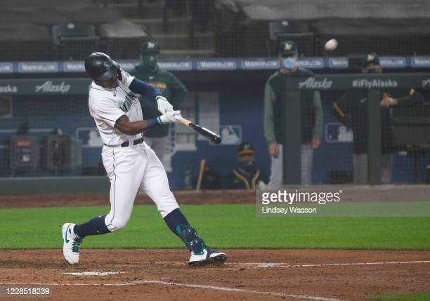 Kyle Lewis of the Seattle Mariners hits a two-run home run in the fifth inning against the Oakland Athletics in the first game of a doubleheader at...