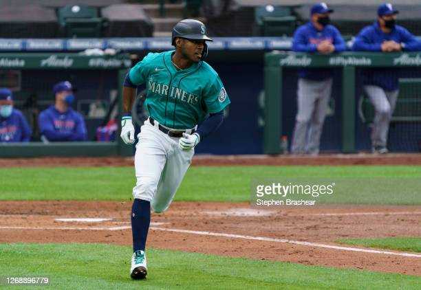 Kyle Lewis of the Seattle Mariners jogs around the bases after hitting a home run during a game against the Texas Rangers at T-Mobile Park on August...