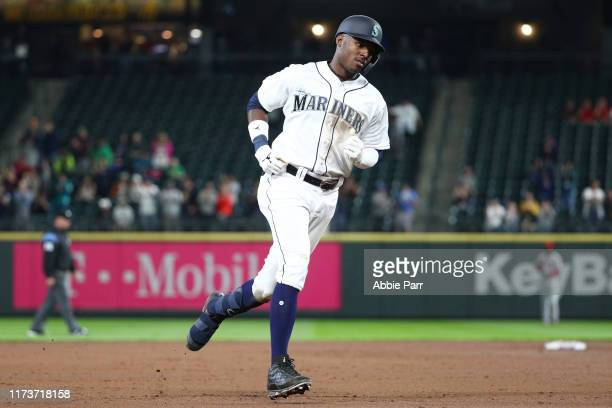 Kyle Lewis of the Seattle Mariners laps the bases after hitting a solo home run against the Cincinnati Reds in the fifth inning to record his first...