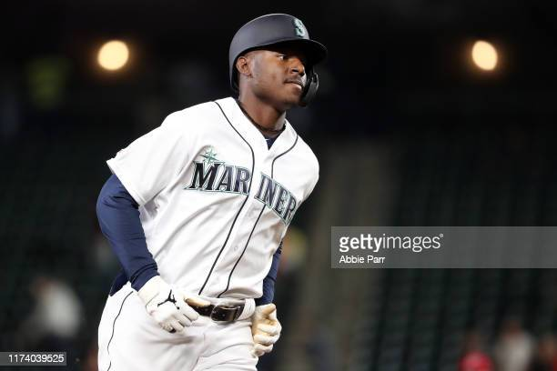 Kyle Lewis of the Seattle Mariners laps the bases after hitting a three run home run against the Cincinnati Reds to give the Seattle Mariners a 3-2...