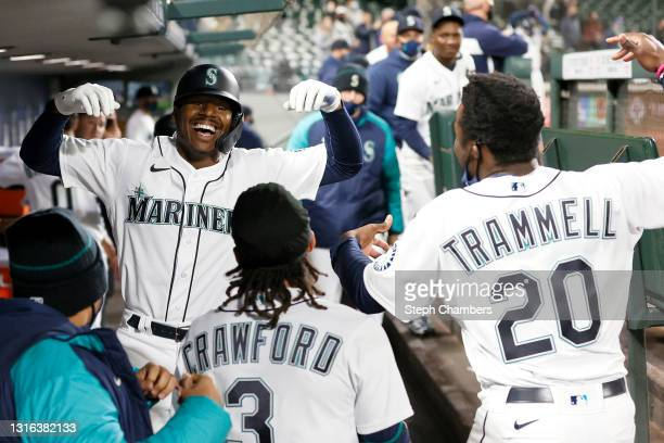 Kyle Lewis of the Seattle Mariners reacts after his three-run home run against the Baltimore Orioles during the eighth inning at T-Mobile Park on May...