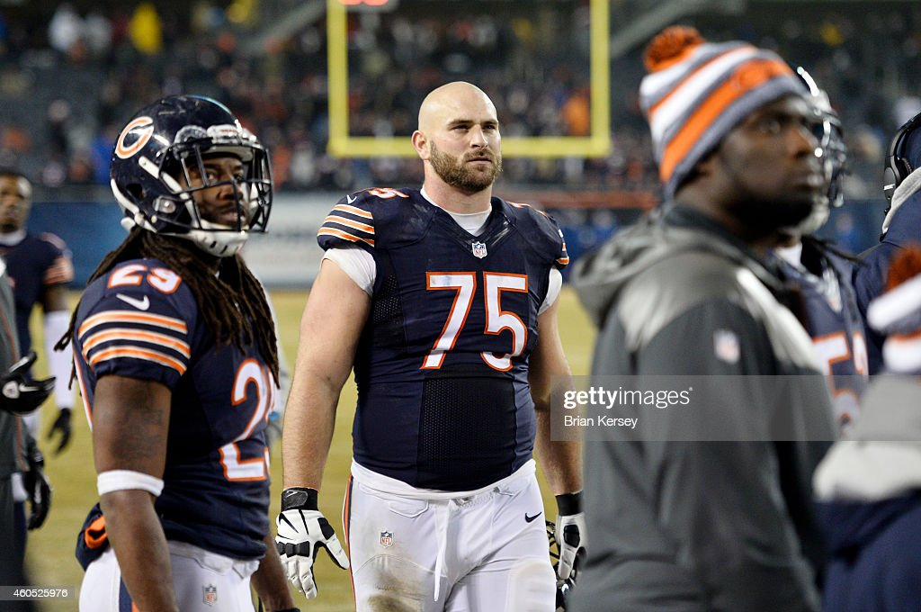 Kyle Long #75 of the Chicago Bears and his teammates watch the replay of a New Orleans Saints touchdown during the fourth quarter on the big screen at Soldier Field on December 15, 2014 in Chicago, Illinois. The Saints defeated the Bears 31-15.