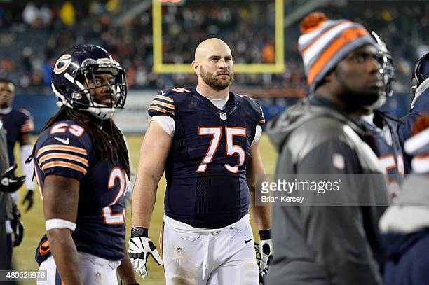 Kyle Long of the Chicago Bears and his teammates watch the replay of a New Orleans Saints touchdown during the fourth quarter on the big screen at...