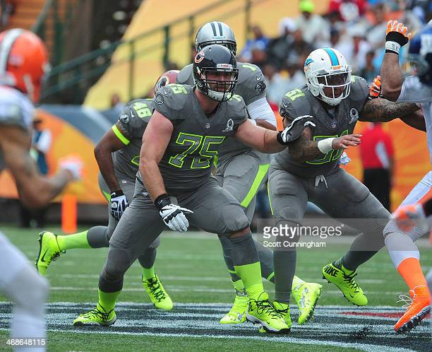 Kyle Long of the Chicago Bears and Mike Pouncey of Team Sanders block against Team Rice during the 2014 Pro Bowl at Aloha Stadium on January 26 2014...
