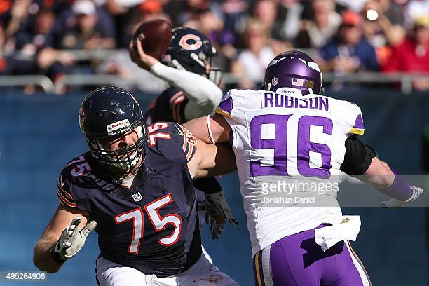 Kyle Long of the Chicago Bears blocks Brian Robison of the Minnesota Vikings in the second quarter at Soldier Field on November 1 2015 in Chicago...