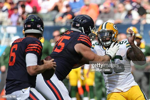 Kyle Long of the Chicago Bears holds back Mike Neal of the Green Bay Packers in the second half at Soldier Field on September 13 2015 in Chicago...