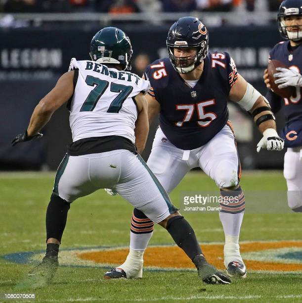Kyle Long of the Chicago Bears moves to block Michael Bennett of the Philadelphia Eagles during an NFC Wild Card playoff game at Soldier Field on...