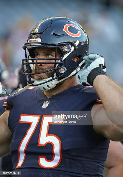 Kyle Long of the Chicago Bears participates in warmups before a preseason game against the Buffalo Bills at Soldier Field on August 30 2018 in...