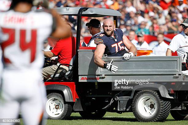 Kyle Long of the Chicago Bears reacts as he is carted off the field following an injury against the Tampa Bay Buccaneers in the first half of the...
