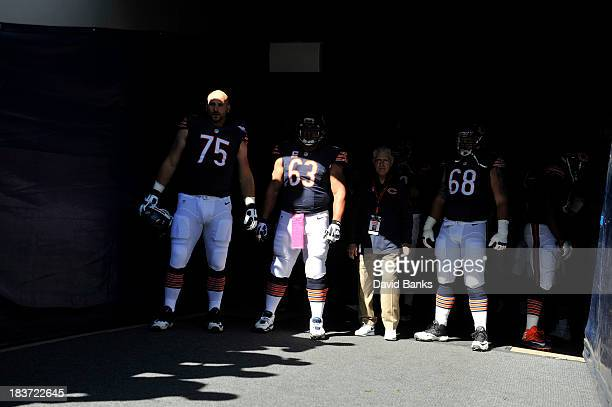 Kyle Long of the Chicago Bears Roberto Garza and Matt Slauson wait to take the field against the New Orleans Saints on October 6 2013 at Soldier...