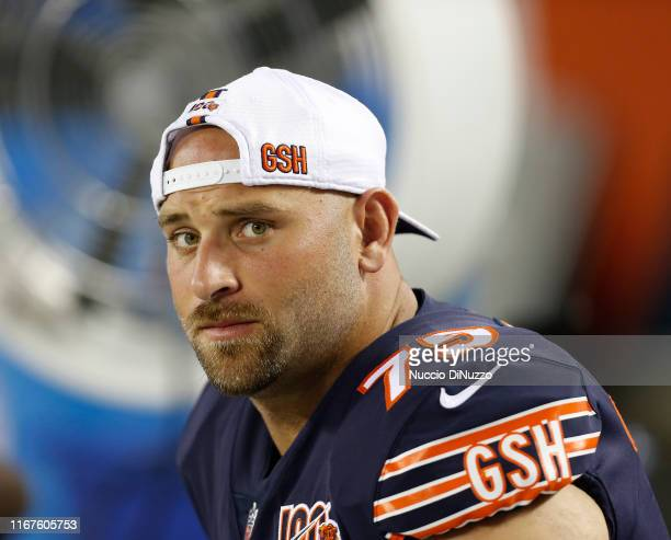 Kyle Long of the Chicago Bears sits on the bench during the second quarter of a preseason game against the Carolina Panthers at Soldier Field on...