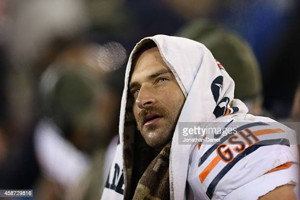 Kyle Long of the Chicago Bears sits on the sidelines in the second half of the game against the Green Bay Packers at Lambeau Field on November 9 2014...