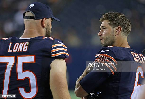 Kyle Long of the Chicago Bears talks with Jay Cutler on the sidelines during a game against the Denver Broncos at Soldier Field on August 11 2016 in...