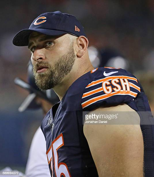 Kyle Long of the Chicago Bearswatches from the sidelines as teammates take on the Denver Broncos at Soldier Field on August 11 2016 in Chicago...