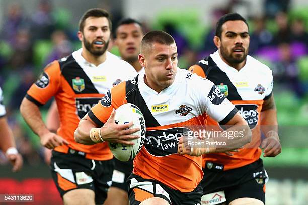 Kyle Lovett of the Tigers runs during the round 16 NRL match between the Melbourne Storm and Wests Tigers at AAMI Park on June 26 2016 in Melbourne...