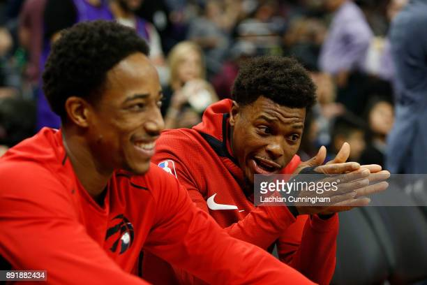 Kyle Lowry of the Toronto Raptors talks to teammate DeMar DeRozan before the game against the Sacramento Kings at Golden 1 Center on December 10 2017...