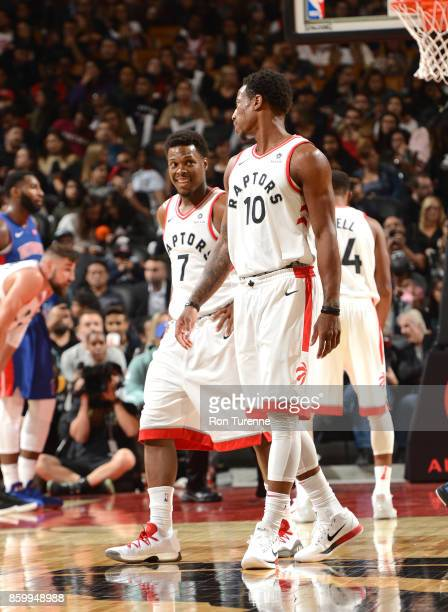 Kyle Lowry and DeMar DeRozan of the Toronto Raptors are seen during the preseason game against the Detroit Pistons on October 10 2017 at the Air...