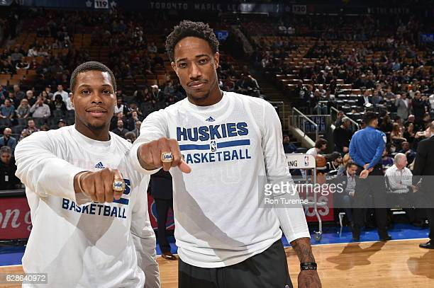 Kyle Lowry and DeMar DeRozan of the Toronto Raptors display their USAB Rings before the game against the Minnesota Timberwolves on December 8 2016 at...