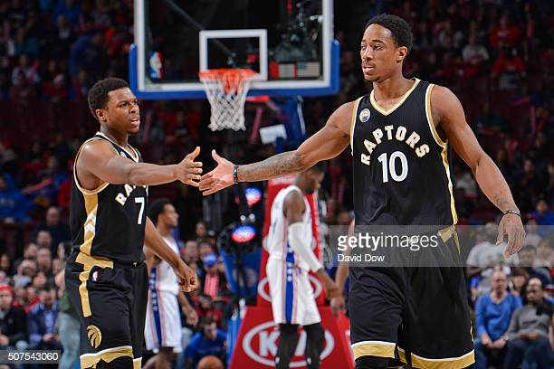 Kyle Lowry and DeMar DeRozan of the Toronto Raptors high five during the game against the Philadelphia 76ers at the Wells Fargo Center on January 9...