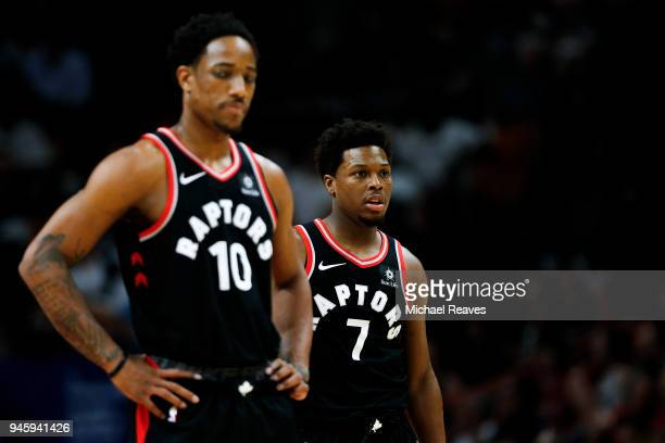Kyle Lowry and DeMar DeRozan of the Toronto Raptors look on against the Miami Heat during the first half at American Airlines Arena on April 11 2018...