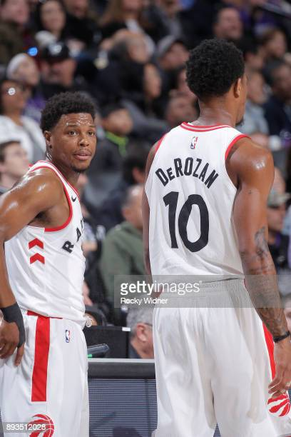 Kyle Lowry and DeMar DeRozan of the Toronto Raptors look on during the game against the Sacramento Kings on December 10 2017 at Golden 1 Center in...