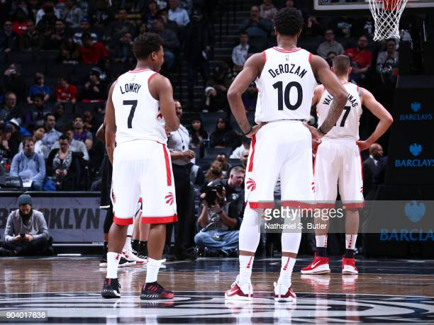 Kyle Lowry and DeMar DeRozan of the Toronto Raptors look on during the game against the Brooklyn Nets on January 8 2018 at Barclays Center in...