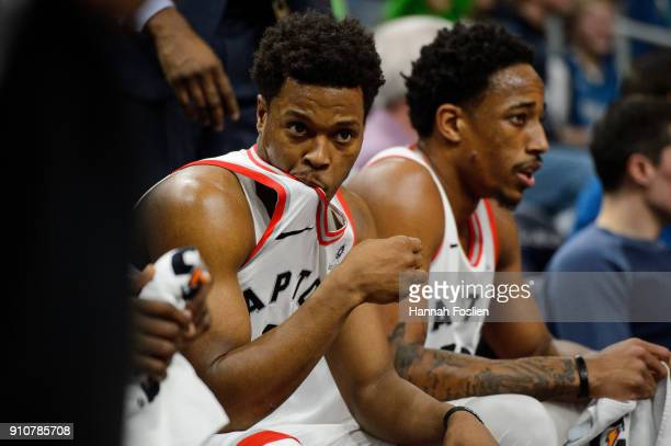 Kyle Lowry and DeMar DeRozan of the Toronto Raptors looks on during the game against the Minnesota Timberwolves on January 20 2018 at the Target...