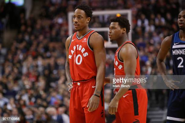 Kyle Lowry and DeMar DeRozan of the Toronto Raptors looks on during the game against the Minnesota Timberwolves on January 30 2018 at the Air Canada...