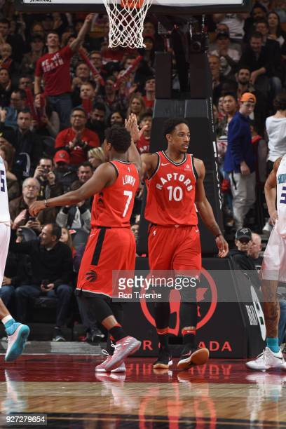 Kyle Lowry and DeMar DeRozan of the Toronto Raptors react to a play during the game against the Charlotte Hornets on March 4 2018 at the Air Canada...