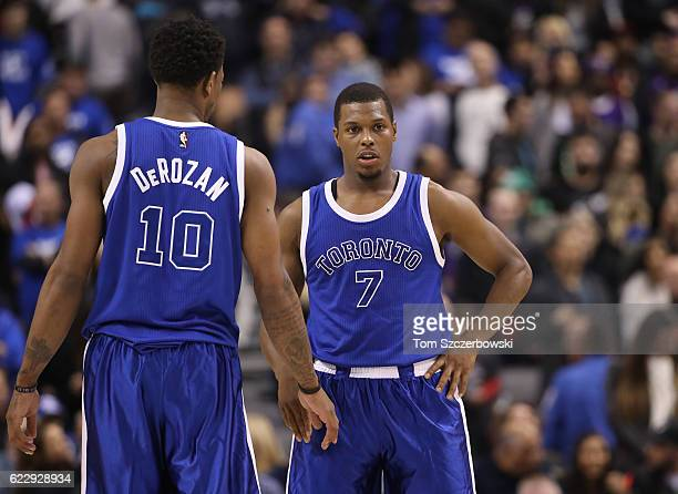 Kyle Lowry and DeMar DeRozan of the Toronto Raptors wear throwback Huskies jerseys during NBA game action against the New York Knicks at Air Canada...