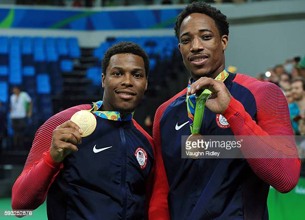 Kyle Lowry and DeMar DeRozan of the USA and the Toronto Raptors of the NBA celebrate winning Gold in the Final match between Serbia and the USA on...