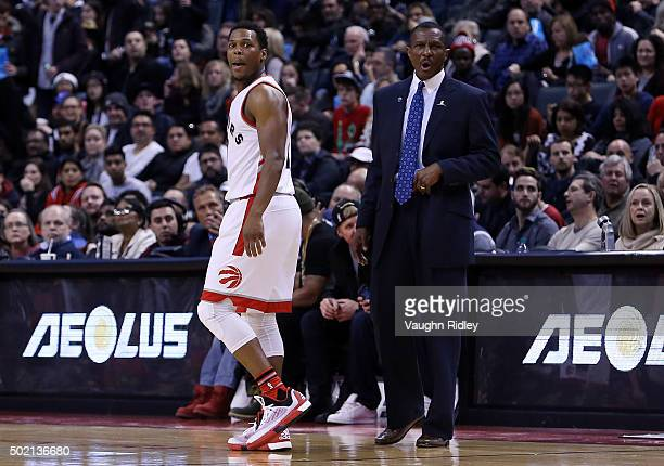 Kyle Lowry and Head Coach Dwane Casey of the Toronto Raptors shout to official Scott Wall after Lowry was ejected from the game in the third quarter...