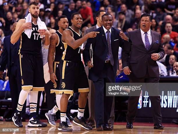 Kyle Lowry and Head Coach Dwane Casey of the Toronto Raptors shouts to the referee during the second half of an NBA game against the Golden State...