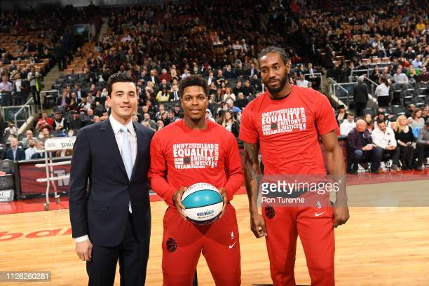 Kyle Lowry and Kawhi Leonard of the Toronto Raptors is presented his 2019 All Star ball prior to the game against the Washington Wizards on February...