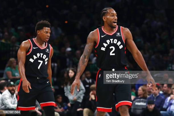 Kyle Lowry and Kawhi Leonard of the Toronto Raptors look on during the first half against the Boston Celtics at TD Garden on November 16 2018 in...