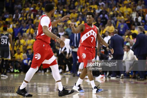 Kyle Lowry and Norman Powell of the Toronto Raptors celebrate the basket against the Golden State Warriors in the first half during Game Six of the...