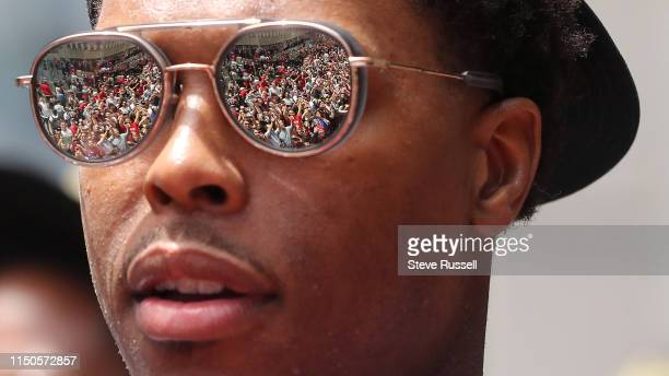 Kyle Lowry checks out the crowd as the Toronto Raptors hold their victory parade after beating the Golden State Warriors in the NBA Finals in...